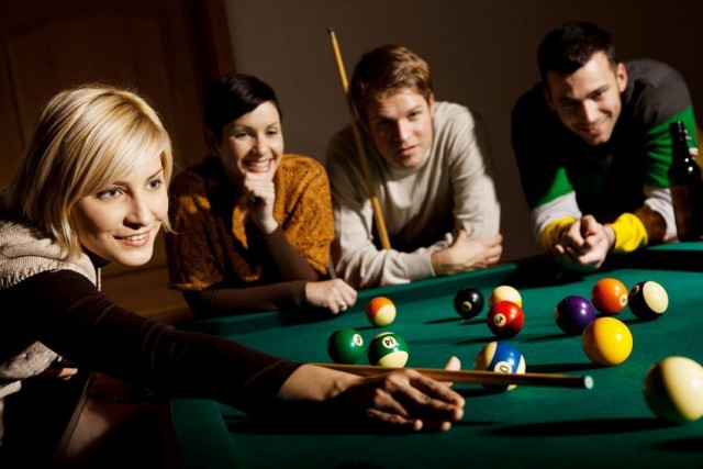 women-play-pool-group