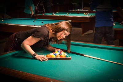 Picture of a woman setting up a game of pool